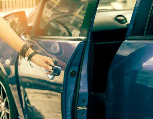 Hipster asian girl open blue car door,retro effect